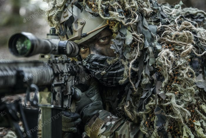 sniper wearing ghillie suit