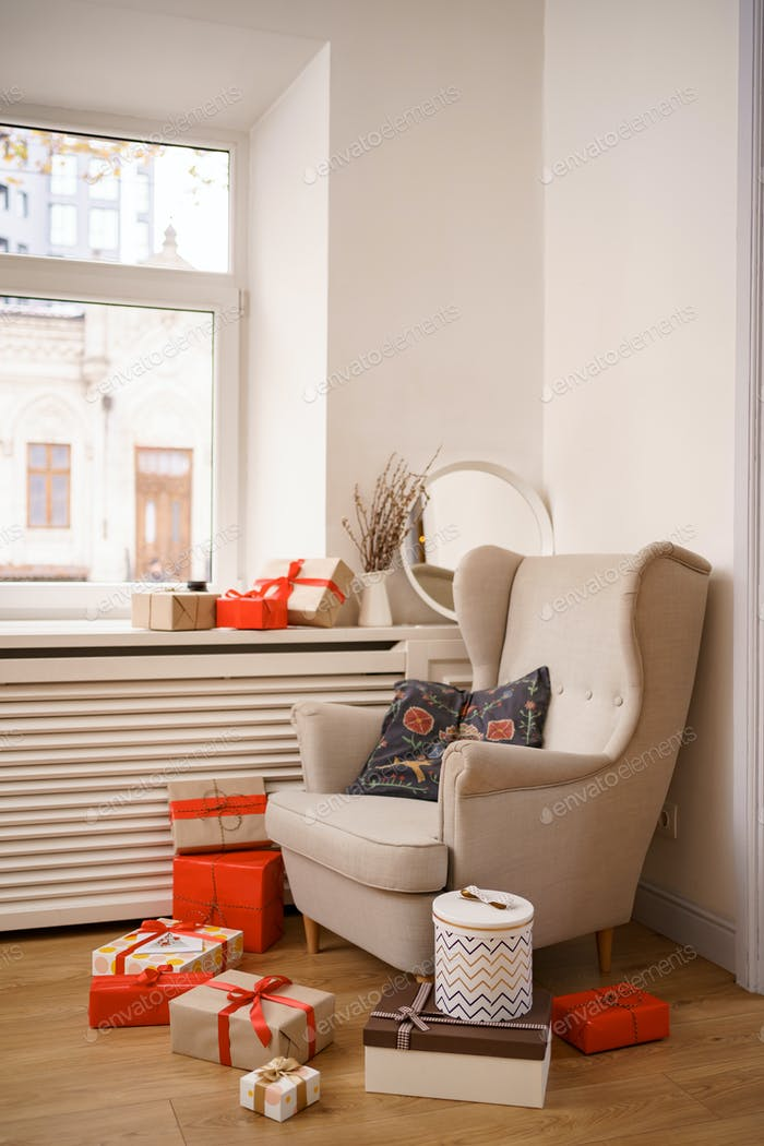 Armchair with gift boxes near window