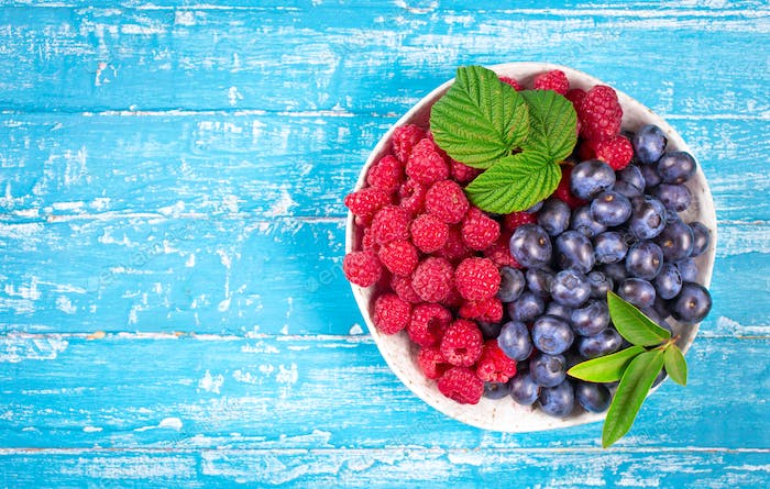 Bowl of raspberry and blueberry above