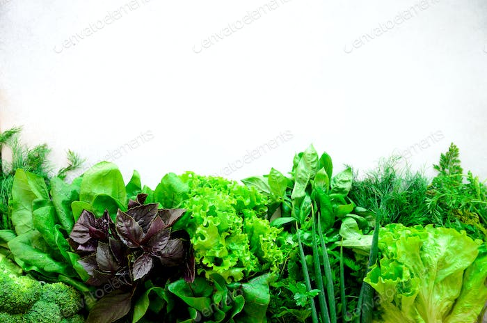 Green fresh aromatic herbs - thyme, basil, parsley on gray background. Food frame, border design