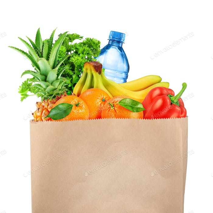Grocery bag with fruits and vegetables isolated on white