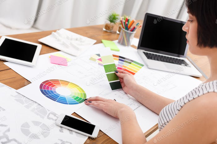 Designer's working table with color palette