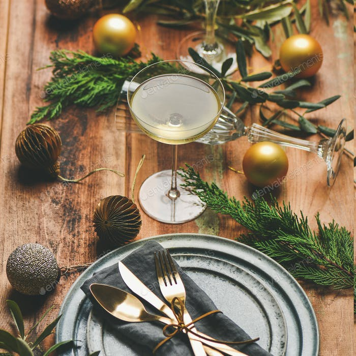 Holiday celebration table setting over rustic wooden background, square crop
