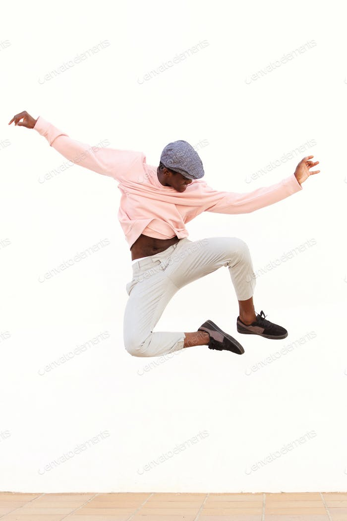 young male dancer jumping on white background