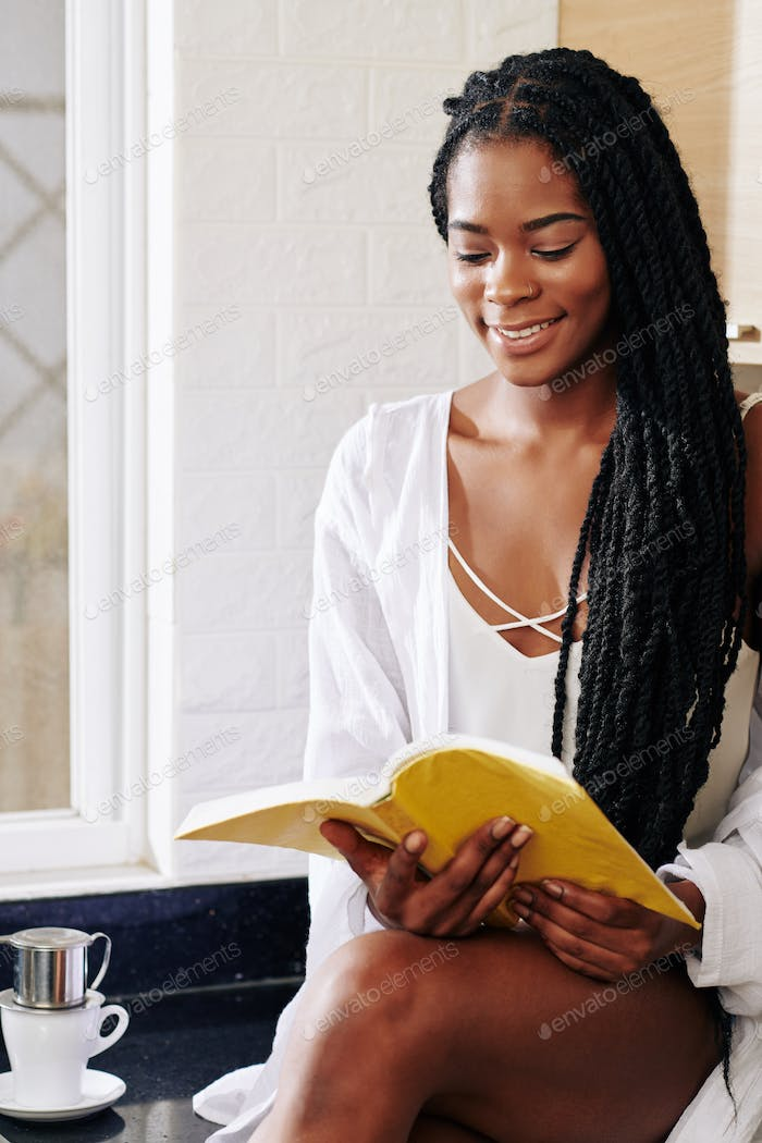 Charming reading young woman
