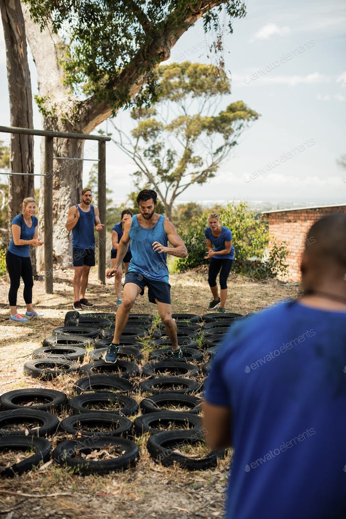 Man receiving tire obstacle course training