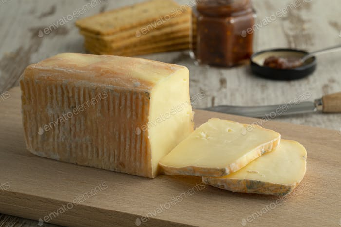 Piece and slices of traditional Italian Taleggio dop