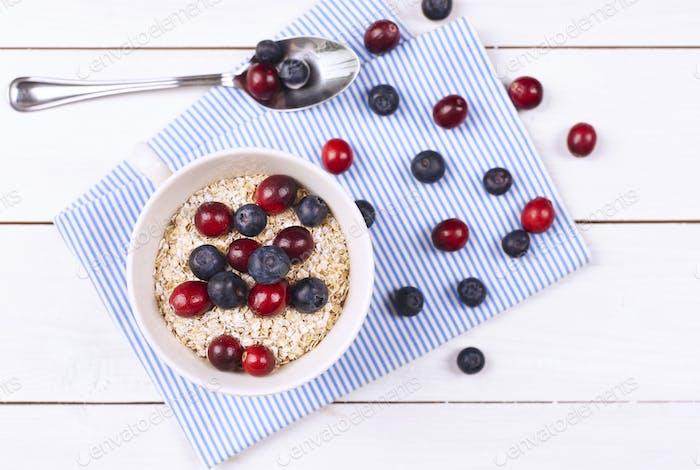Tasty porridge with fruit on wooden table