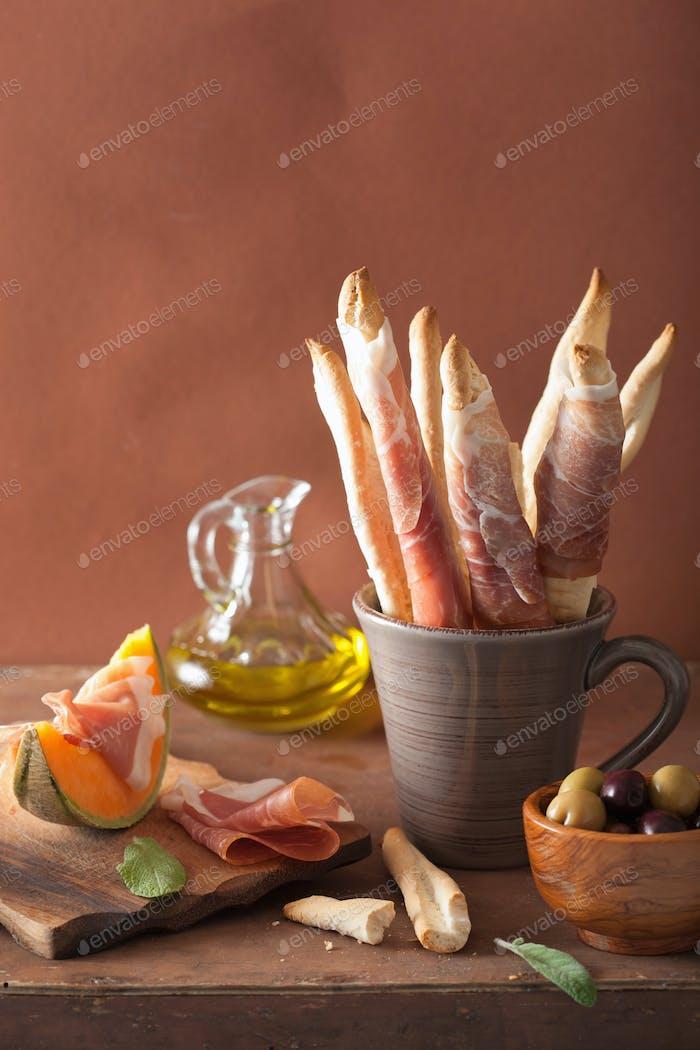grissini with prosciutto cantaloupe melon olives. italian appeti
