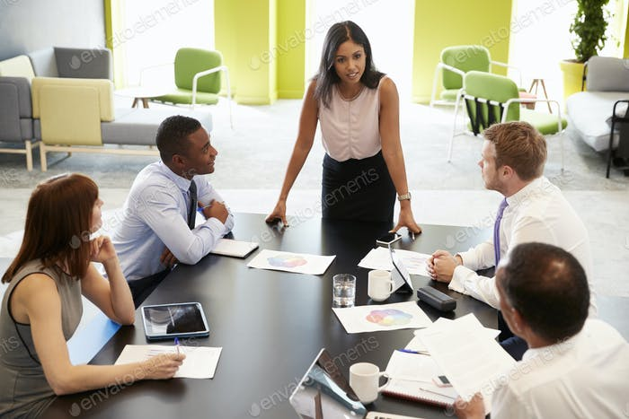 Female boss standing at informal meeting, elevated view