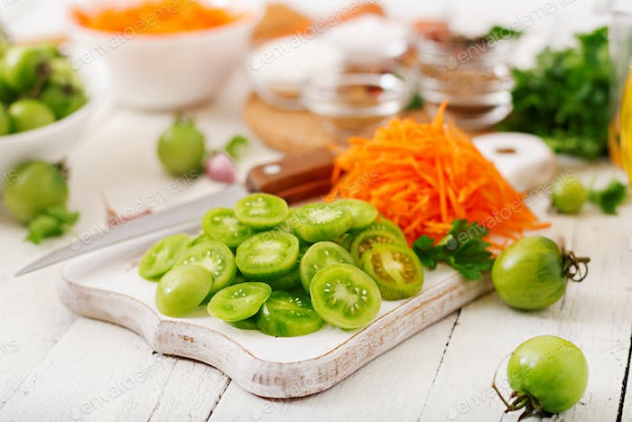 Ingredients for Korean salad from green tomatoes and carrots.
