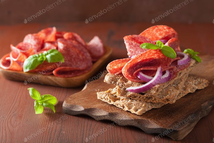 crisp bread with salami and red onion