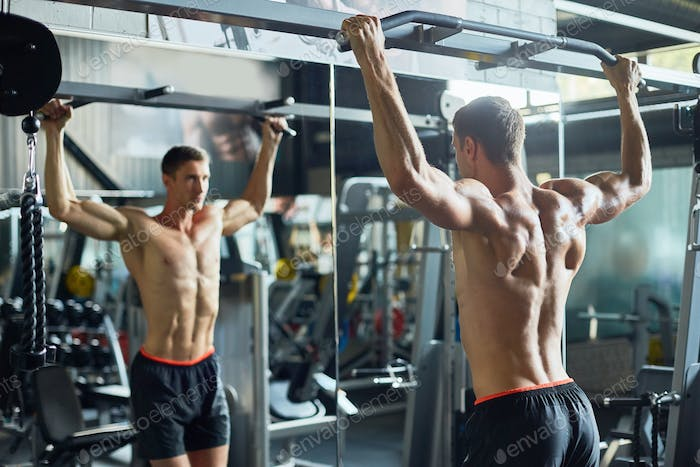 Handsome Bodybuilder Concentrated on Training