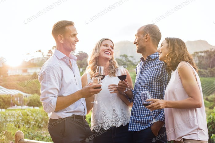Happy friends drinking wine