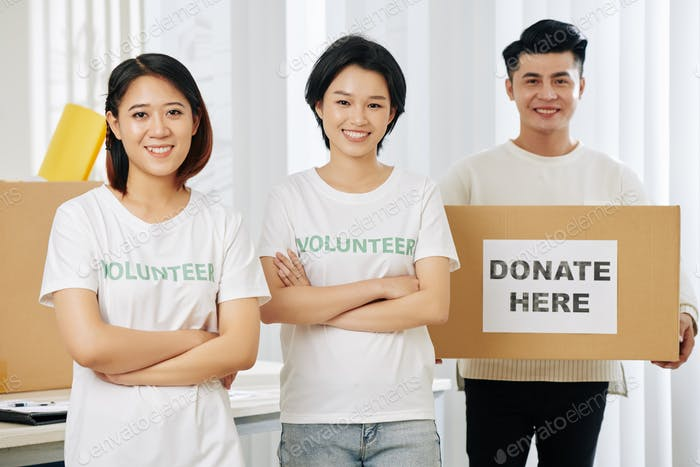 Young happy volunteers