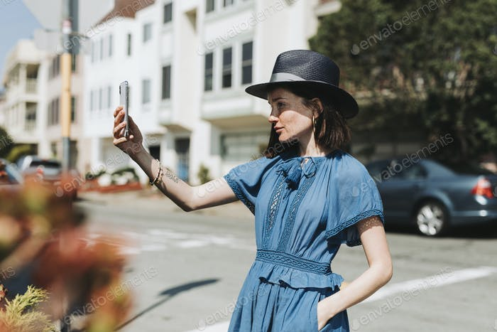 Woman taking a selfie in a city