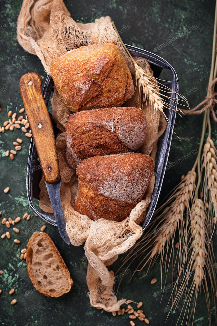 Fresh homemade buns on rustic background