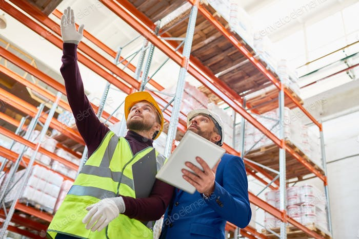 Warehouse Worker Taking to Investor