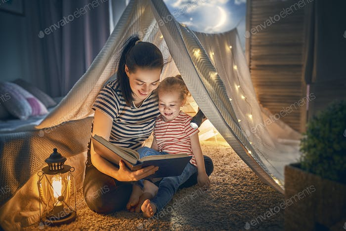 Mom and child reading book