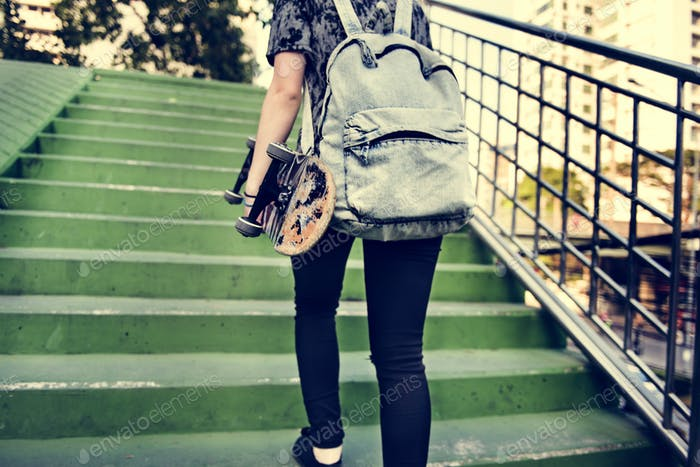 Young Woman Skateboard Standing Outdoors Bridge Concept