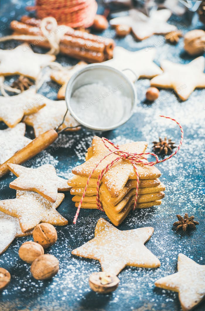 Homemade gingerbread cookies with cinnamon, anise and nuts, plywood background