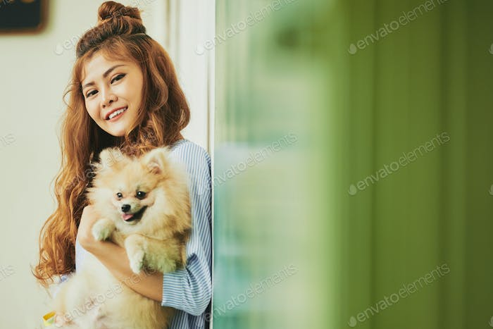 Cheerful girl with dog