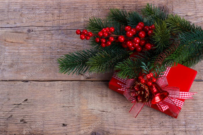 Pine branch with gift box