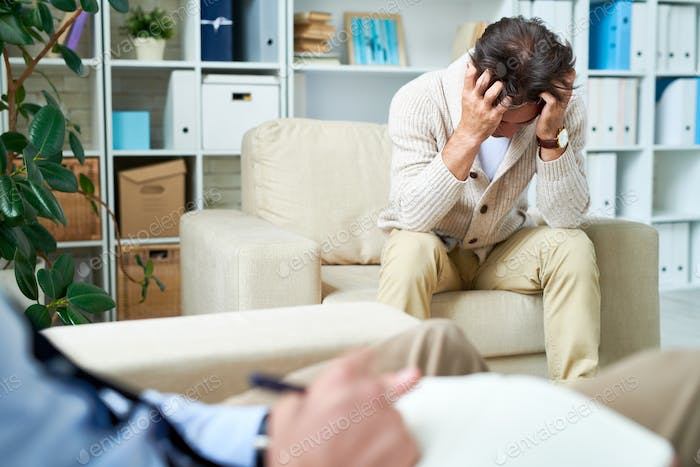 Depressed man at psychotherapy session