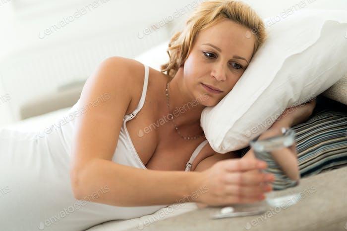 Pregnant woman taking medication
