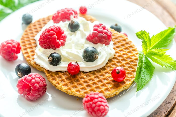Belgian waffles with whipped cream and fresh berries