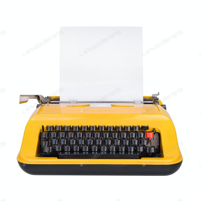 Yellow typewriter isolated on white