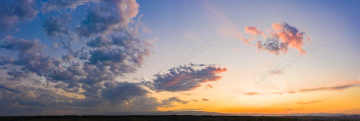 Panorama of sky. Orange blue and violet color sunset sky background
