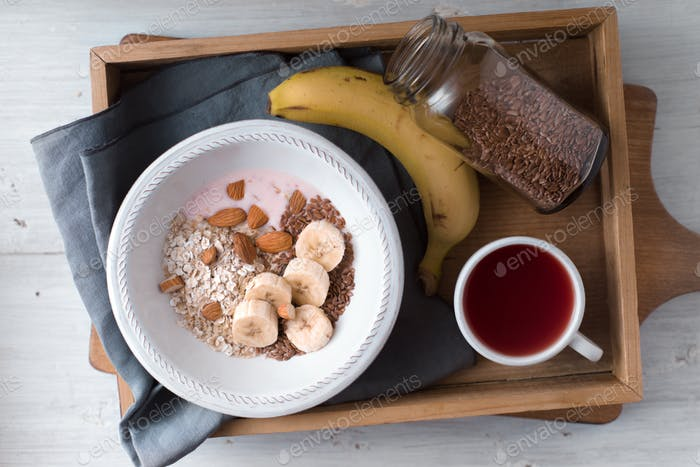 Healthy breakfast on the wooden tray  top view