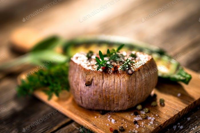 Grilled beef steak  on wooden cutting board