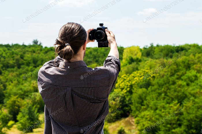 Young man taking selfie shot on outdoor.