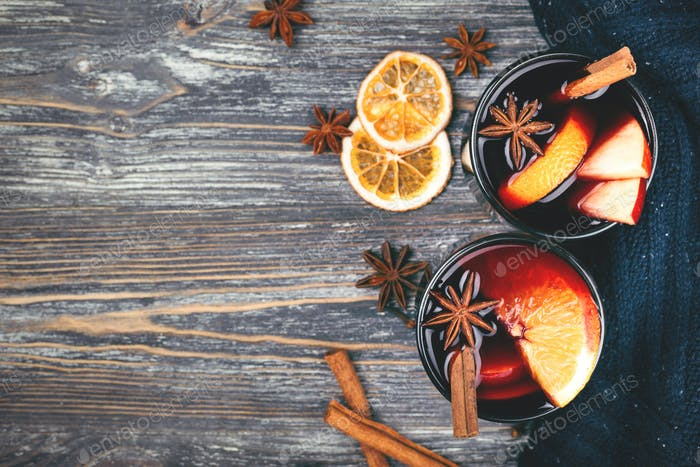 Two Glasses of Mulled Wine on Wooden Background.