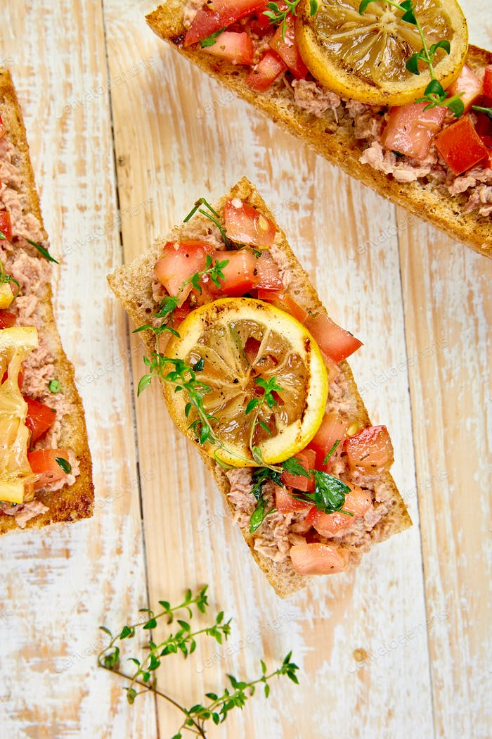 Appetizer bruschetta with tuna and tomatoes. Italian cuisine.