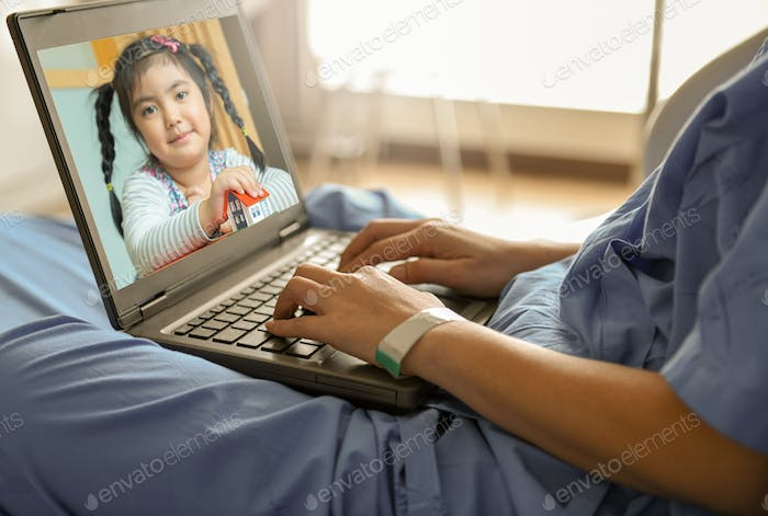 The patient is using a video call by laptop to talk to her daughter at home.
