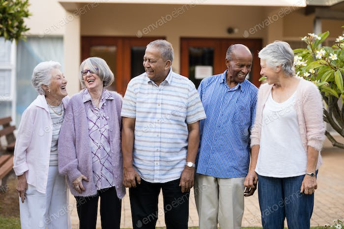 Cheerful senior men and women at nursing home