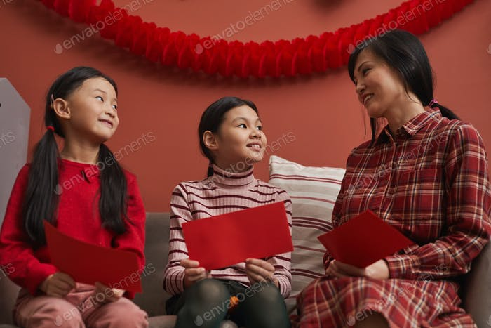 Chinese Family Preparing Red Envelopes