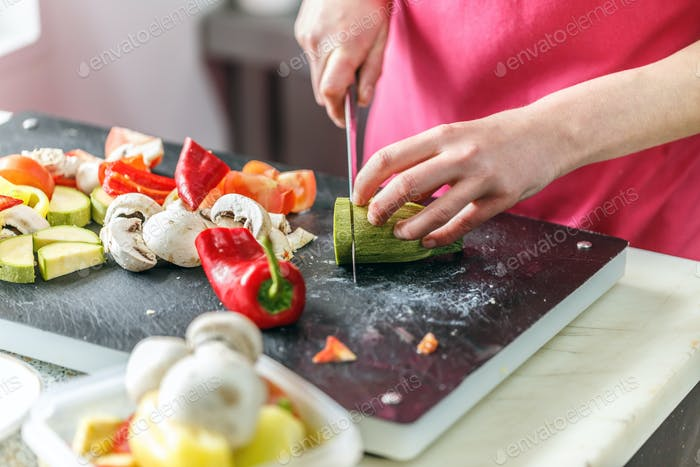 Chef is chopping vegetables
