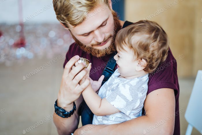 Young father holding his son