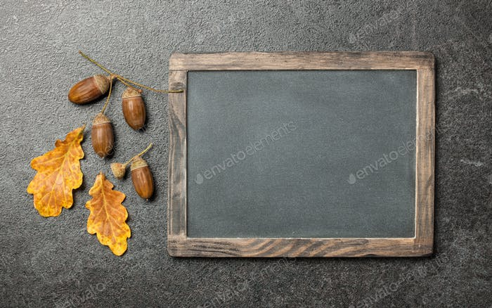 Thanksgiving card with oak leaves, acorns and chalk board