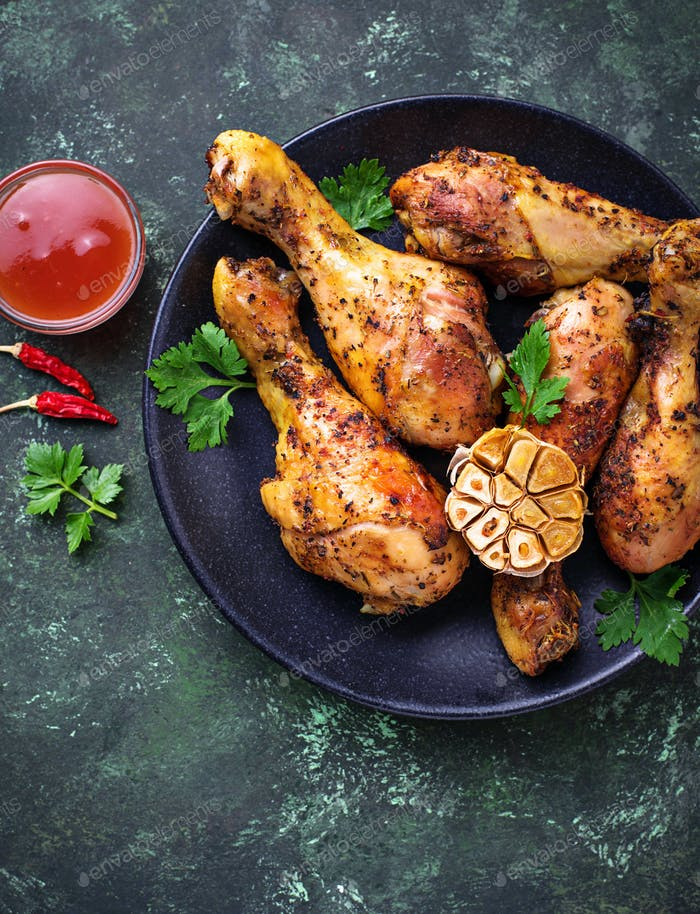 Grilled chicken legs with spices and garlic.