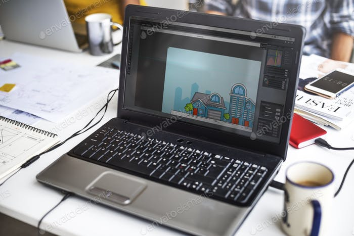 Laptop Screen Showing Graphic House Exterior Design on Desktop