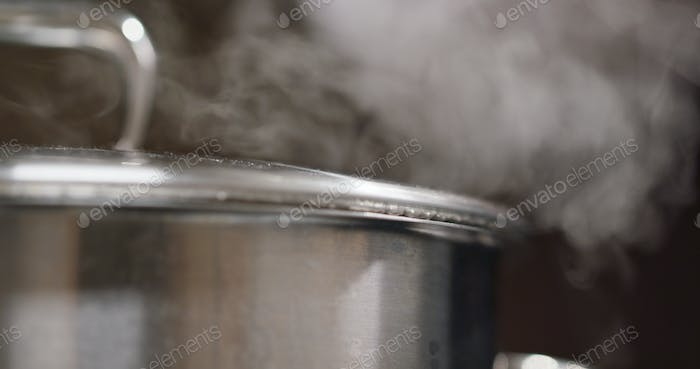Pot boiling on a gas stove in the kitchen