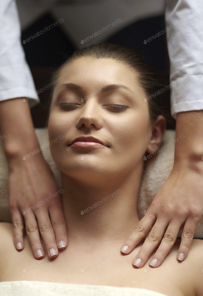 Natural woman pampered at spa