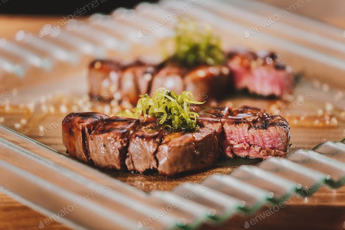 Grilled steaks with herbs