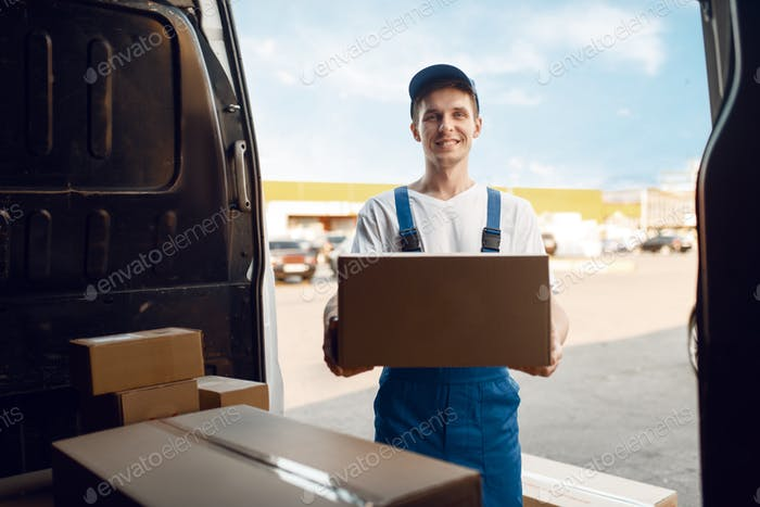 Deliveryman unloads the car with parcels, delivery