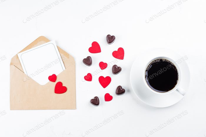 Valentines day mockup. Love card. Coffee cup, chocolate candy, paper card with envelope